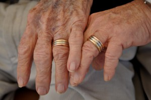 Brandy Wight, left, and husband, Bruce Blackwell, right, showcase their wedding rings made from yellow, white and pink gold. They were legally married in Massachusetts in 2004.