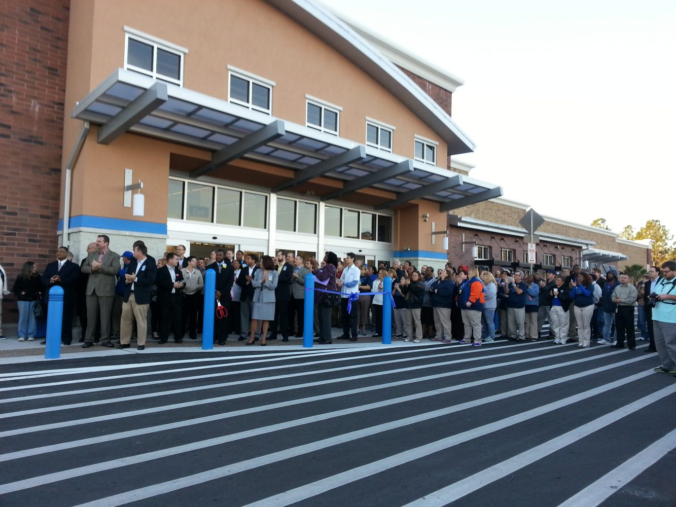 Customers and employees stand outside of Wal-Mart awaiting the 8 a.m. grand opening.