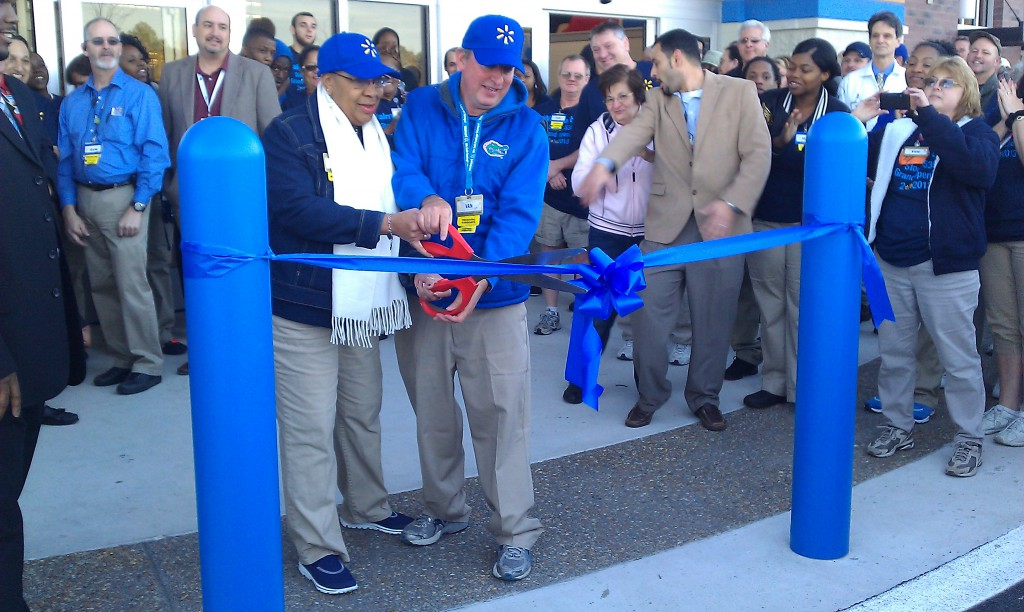 Jackie Kelley and Van Williams cut the ceremonial ribbon at the grand opening of the Wal-Mart. Kelley and Williams worked at the Wal-Mart on 13th Street since 1983.