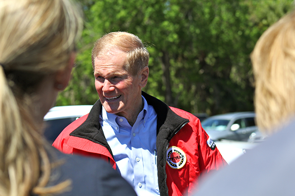 Sen. Bill Nelson talks to the media and Marion County commissioners at Silver Springs on Tuesday afternoon.