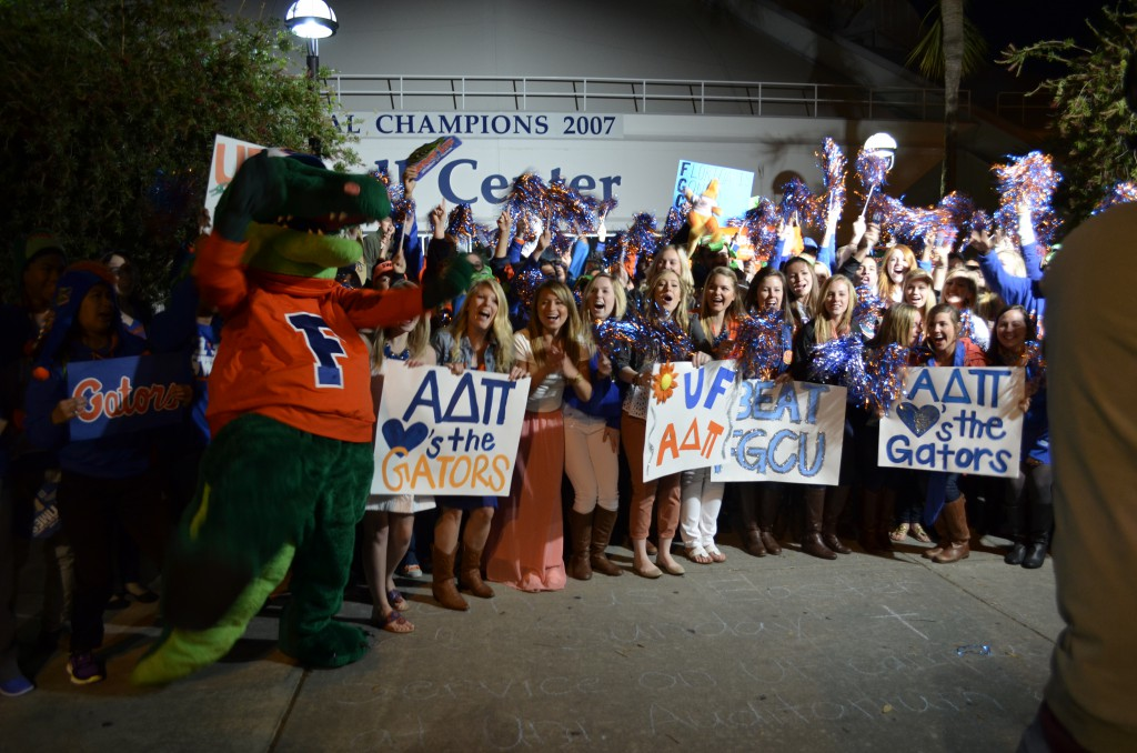 Students cheer with Albert, the UF mascot, before the show.