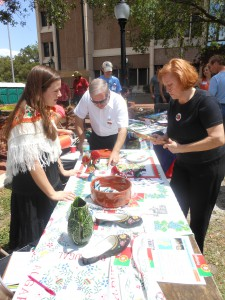 "Attendees visit Portugal display table at  the  2012 ""Viva Europe!"" festival in downtown Gainesville."