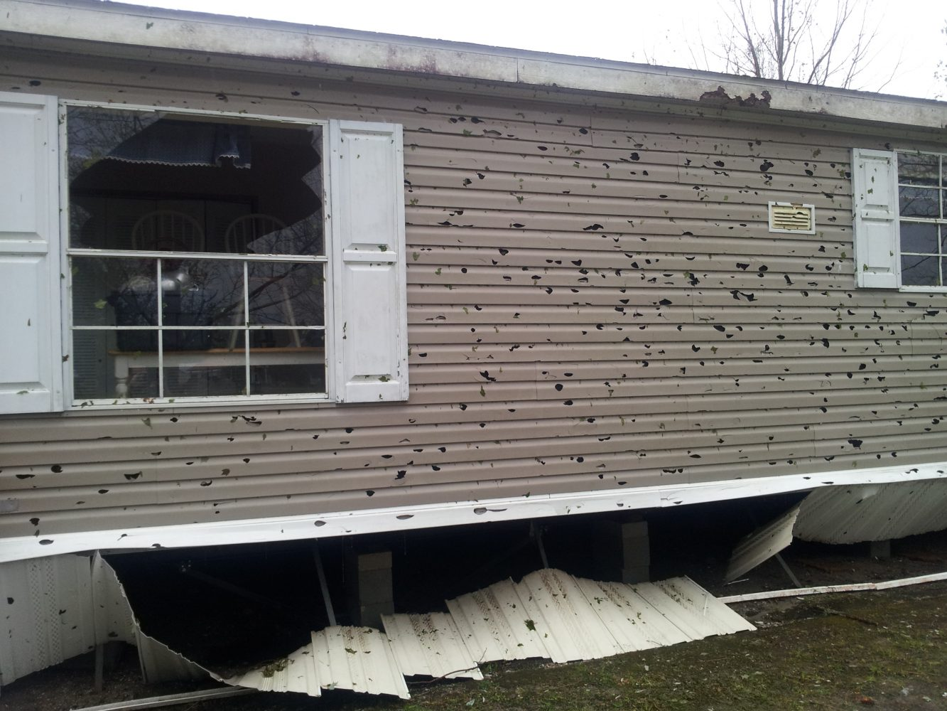A mobile home near Lawtey was damaged by hail and left with holes and broken windows. Courtesy: Bradford County Emergency Management