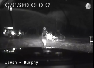 Footage from the dashboard cam showed the damage to Lowe's car while police wait for the tow truck to arrive. According to the footage, Lowe was in custody in the back seat when this image was captured.