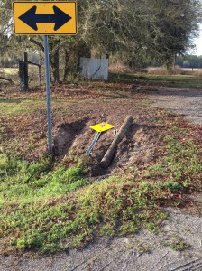 A street sign is knocked over at the intersection of NE 156th Avenue and NE 21st Street Thursday morning. The arrest report cites this as the area where Gainesville Mayor Craig Lowe was found by FHP officers.