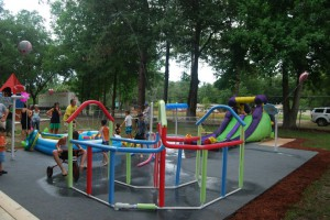 Campers play in the splash park at last year's Super Hero camp.