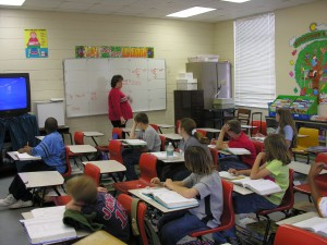 A fifth grade teacher teaches a math class.