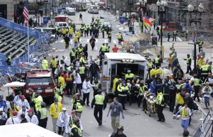 Medical workers aid injured people at the finish line of the 2013 Boston Marathon following a series of explosions Monday.