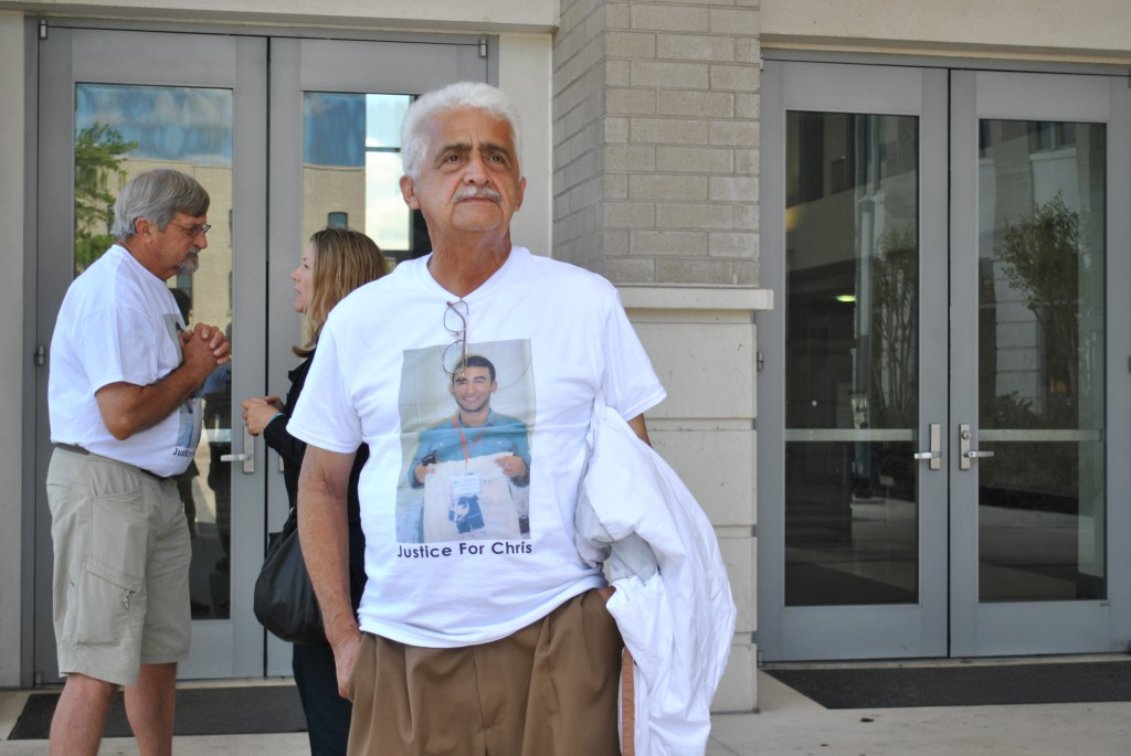 Carlos Aguilar Sr., Christian Aguilar's grandfather, drove to Gainesville from South Florida with his family for the hearing of Christian's alleged murderer. He stood outside of the courthouse after the hearing while his son spoke to media representatives.