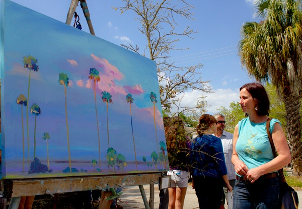 Nitya Goodwin, 57, of Gainesville, admires a painting Sunday at the 44th annual Santa Fe College Spring Arts Festival in Gainesville.