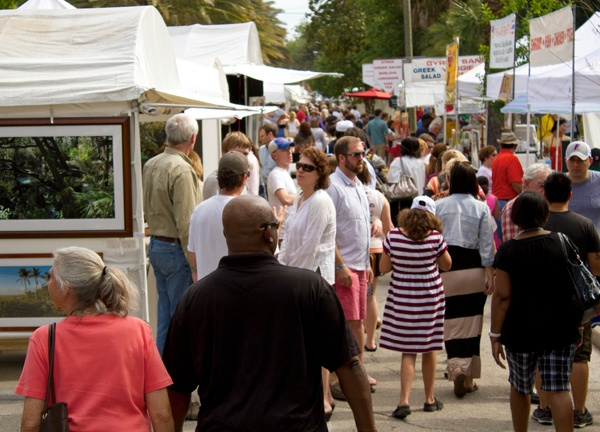 Crowds walk along Northeast 1st Street in downtown Gainesville on Sunday for the 44th annual Santa Fe College Spring Arts Festival. An estimated 110,000 people attended the two-day event.