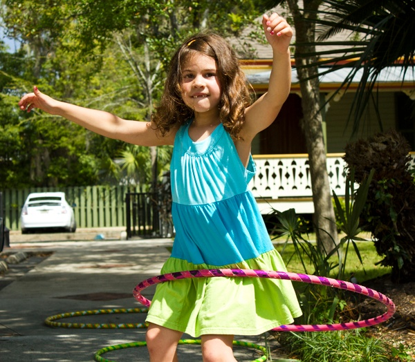 Anastasja Fernandez-Smith, 6, Hula-Hoops on Sunday at the 44th annual Santa Fe College Spring Arts Festival in downtown Gainesville.