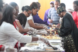 Members of Delta Sigma Theta sorority serve food to participants at the arts festival reception. The alumnae chapter of the sorority hosted the event along with the almuni chapter of Omega Psi Phi fraternity.