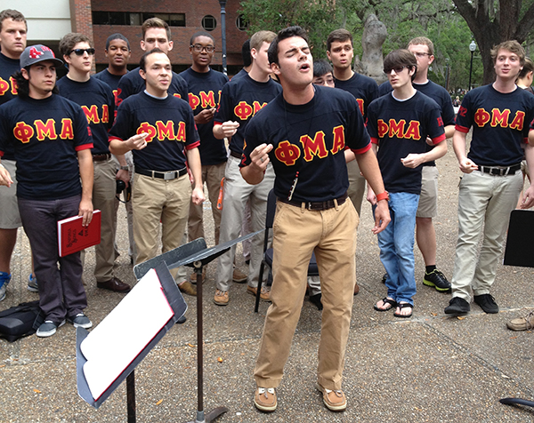 UF's Phi Mu Alpha group sings for donations Wednesday in honor of the victims of the Boston Marathon bombings.
