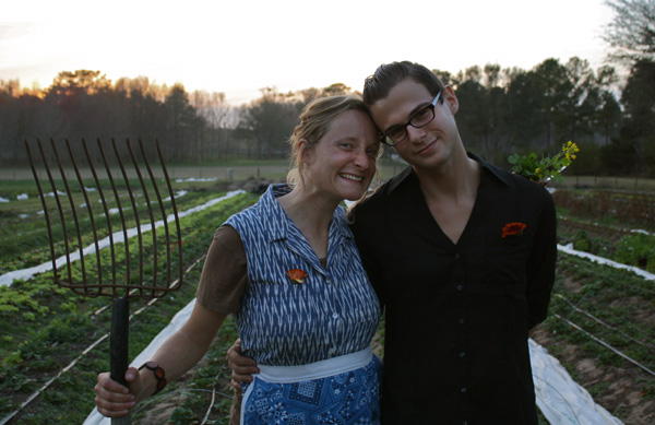 Nic with a friend at Swallowtail Farm in February 2012. Photo by Eva Suarez.