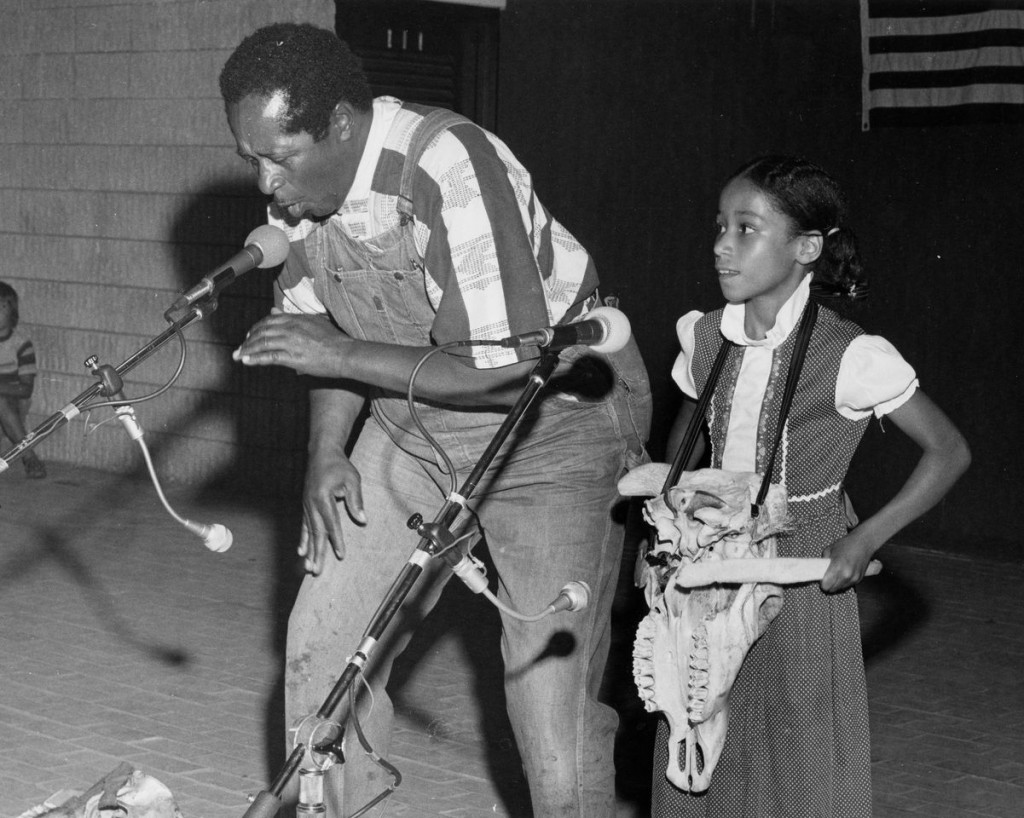 Abner Jay performing with a young girl, year unknown.
