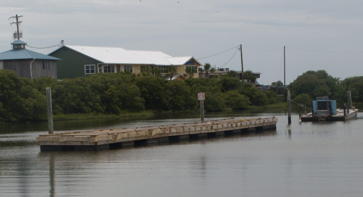 The town's floating dock has been moved into the marina in preparation for severe weather and tide levels.