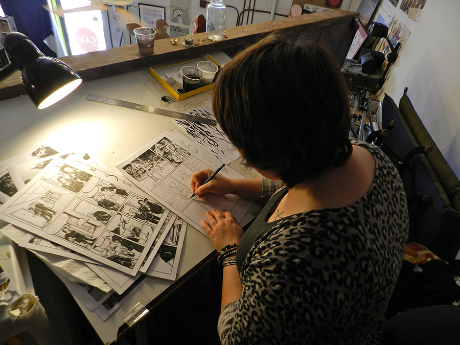 Sally Catirino, who took classes with Hart in New York, works at her desk in S.A.W.'s loft space. Catirino moved to Gainesville from New Jersey to work with Hart. She was a student in the year-long program and will help him teach this summer's teen classes.