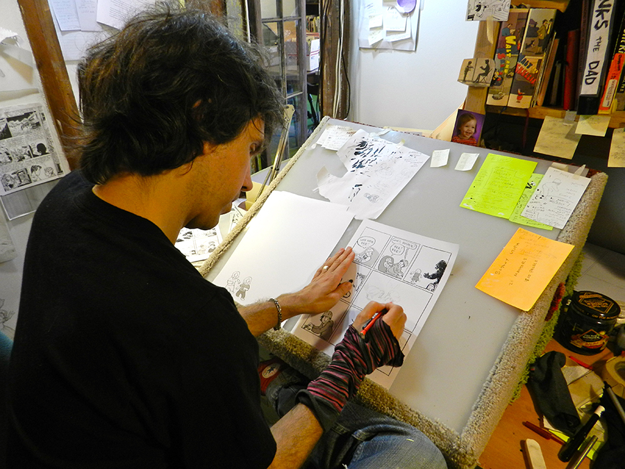 Tom Hart, founder and owner of the Sequential Artists Workshop, is currently working on a personal memoir. He wears a sock as he draws to prevent any smudging.