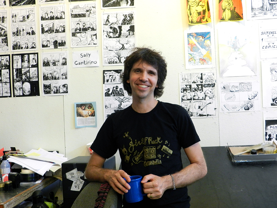 """Hart displays his year-long students' work on the walls. Although there was a small comics community before S.A.W., the space has generated more interest. """"We pulled a lot of people out of the woodwork,"""" he said."""
