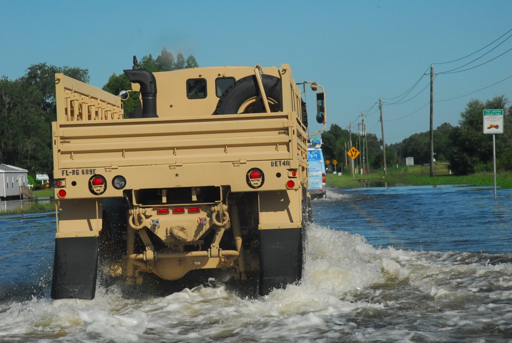 Florida National Guard soldiers used high-water vehicles in 2012 to navigate the Tropical Storm Debby flooding in Live Oak.