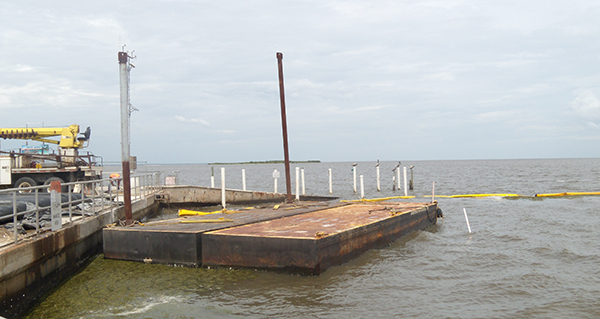 Temporary barges are being utilized to prepare for high water levels.