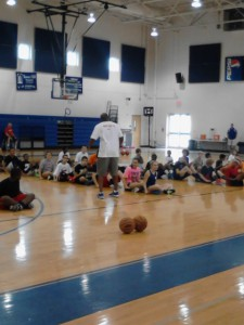 Dan Cross speaks to youth basketball players Thursday at St. Francis High School.
