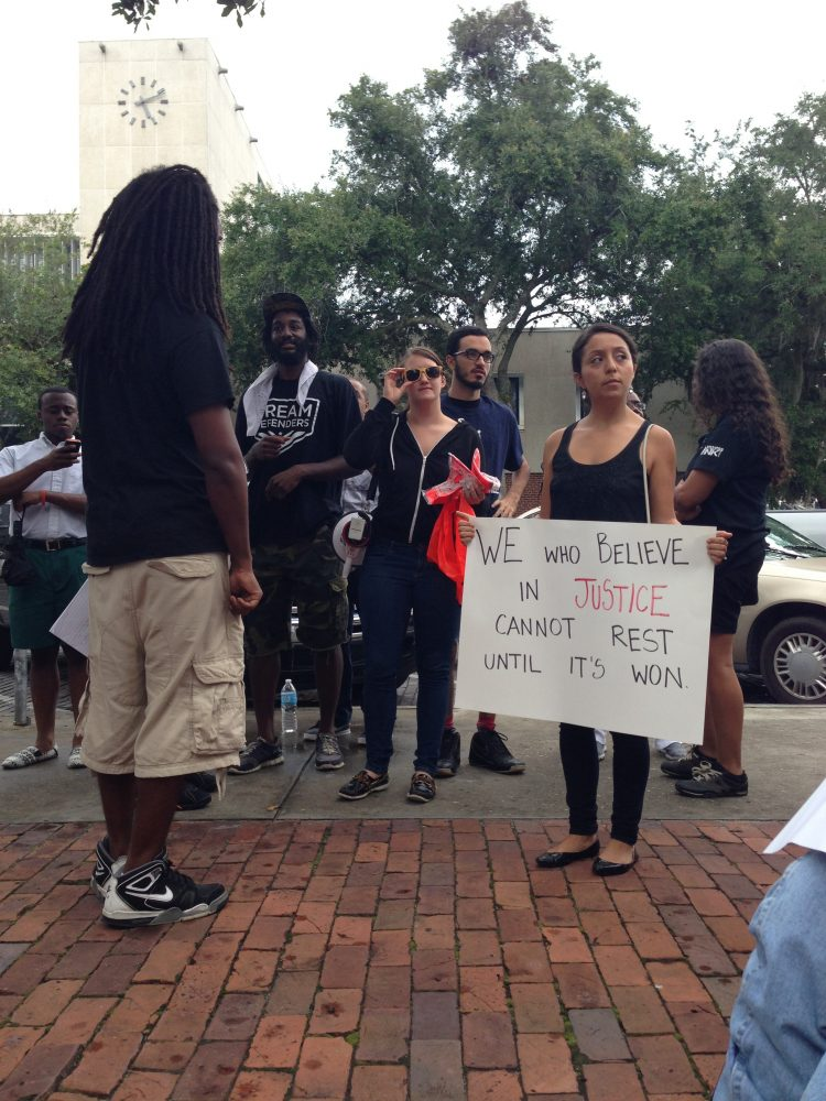 Protesters gather Monday at Bo Diddley Plaza in Gainesville to protest the not guilty verdict in the George Zimmerman Trial.