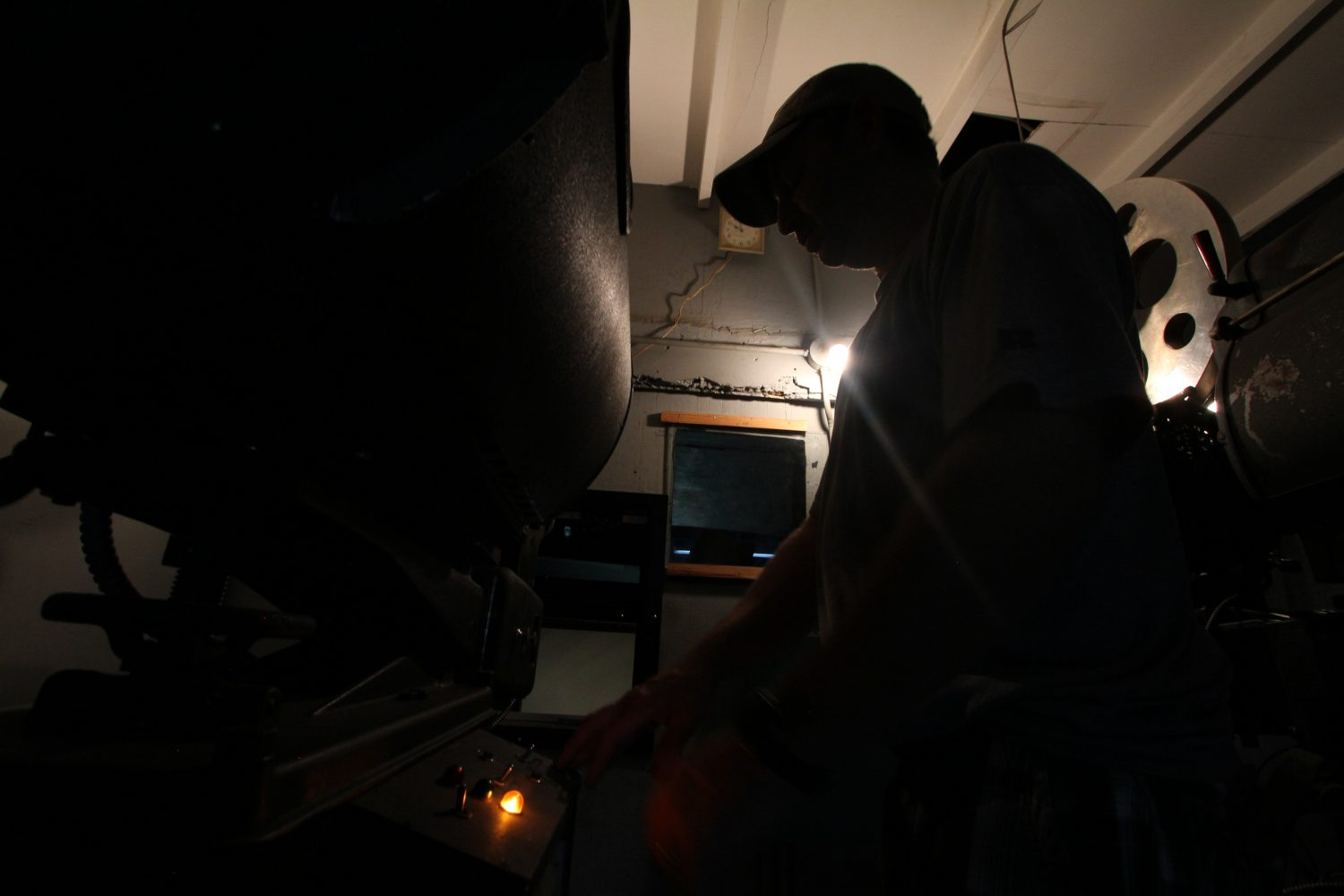 Alan Alligood turns on the Priest Theatre's film projection unit, which will soon be replaced by a digital version.