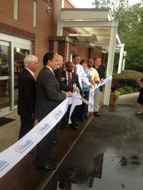 UF Health officials cut a ribbon at the emergency department ceremony on Wednesday.