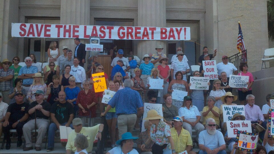 A crowd gathers to rally outside the Franklin County courthouse regarding the Apalachicola River water flow issue.