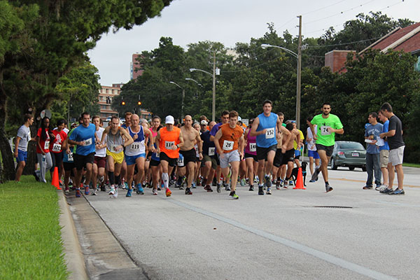 About 150 runners take off from the Project Haiti 5K race starting line Saturday morning on at the University of Florida campus on Gale Lemerand Drive