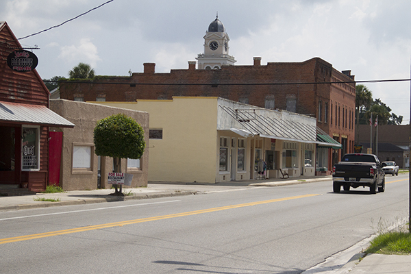 On most days, downtown Mayo is quiet and empty. Trucks trundle along Main Street, which is also the highway. Three shops are open; the rest are for sale or rent. Walking down the street, surrounded by blank doors and few residents, the town often seems deserted.