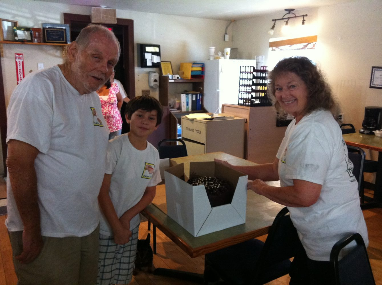Bill, left, and Verna Brown, right and great-grandson Iziah try to help feed as many impoverished and hungry Levy County residents as they can.