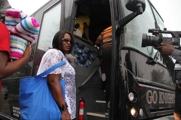 Participants board the charter bus that will drive them 10 hours for the commemoration of the March on Washington.
