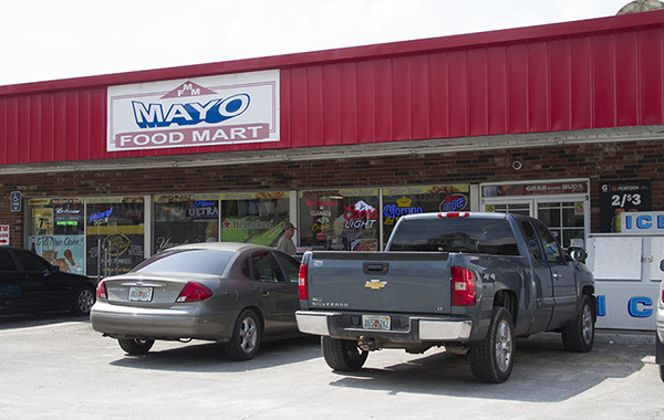 """The most we can sell you is 6.42-percent alcohol. Liquor is way more than that. I wish we could sell here,"" said Dharmendra Thakor, an employee at Mayo Food Mart, a local general store at 133 W Main St. ""I wish."""