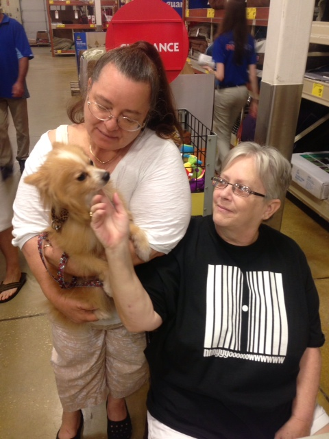 Linda Powell and her roommate play with the newest addition to their household Foxy.