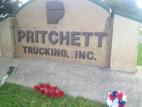 At the foot of the Pritchett parking sign in Lake butler, someone laid a bouquet of eight red roses in the grass to commemorate the victims. Beside them sat a cup of red, white and blue carnations. And to the right, a bundle of purple flowers wilted on the concrete.