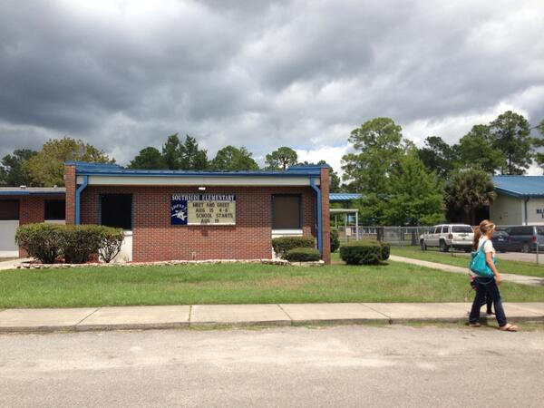 A mother walks her child out of Southside Elementary School in Starke Tuesday. Southside Elementary will temporarily house Kindergarten and fourth grade Starke Elementary students until Starke Elementary School is cleared of mold. Administrators do not know when students will be able to return to Starke Elementary.