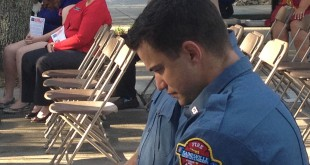 A Gainesville firefighter bows his head during one of two moments of silence. Each moment of silence marked the moment when one of the two planes struck the twin towers on Sept. 11.
