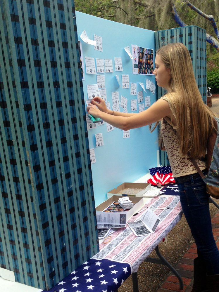 Kyndelle Allen, a University of Florida student, pins her good deed on the twin towers replica.