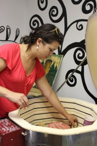 Gainesville businesswoman Rebecca Barborak tends to pottery pieces at Cork & Colors Canvas and Pottery Studio, one of her three art studios. Female-owned businesses are on the rise, according to the 2013 State of Women-Owned Businesses Report.