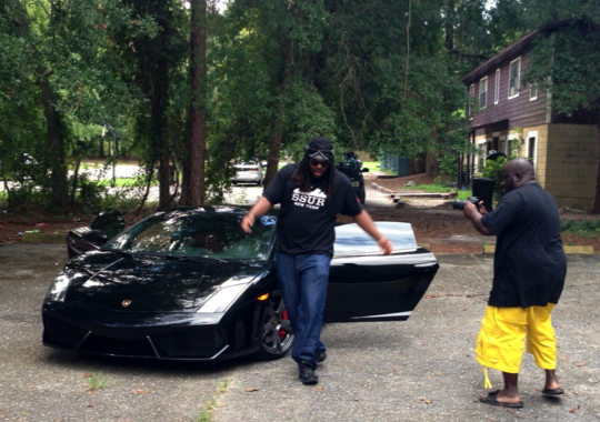 DjX Performs Around The Lamborghini Gallardo That He Rented In Linton Oaks  On Sunday For The