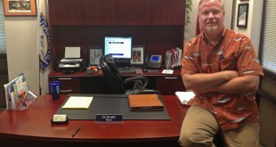 Mayor Ed Braddy sits on his desk in Gainesville City Hall on Monday. Before becoming mayor, Braddy had worked as a political talk radio host, Gainesville city commissioner and testing administrator for Santa Fe College.