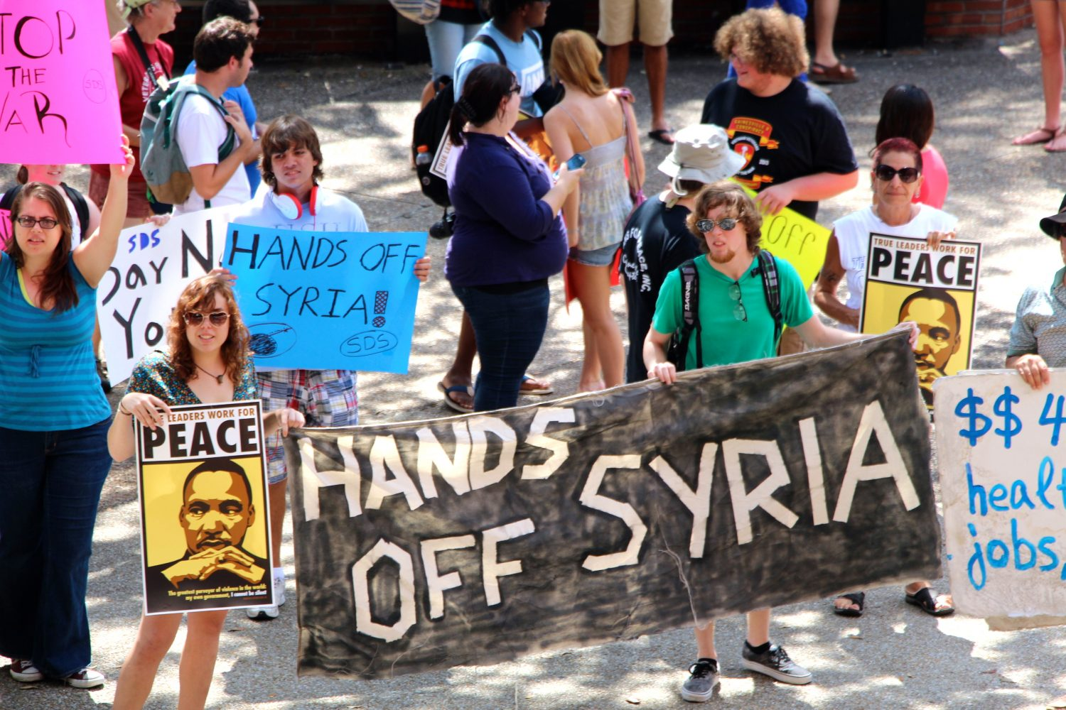 Close to 30 protesters showed up at the anti-war rally at UF's Turlington Plaza Friday.