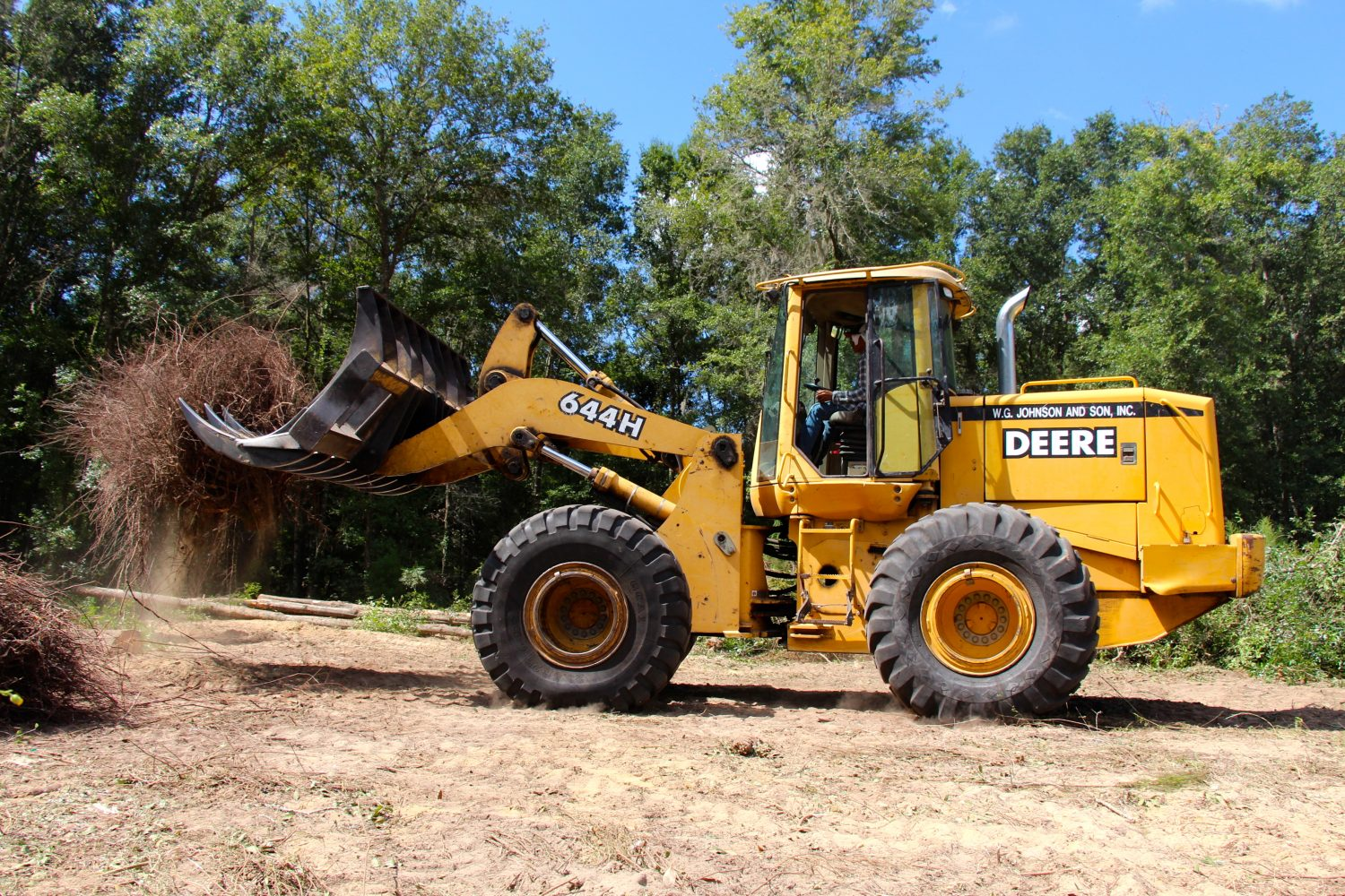 Bulldozers work constantly to clear more land, as builders race against time from building one house to the next.