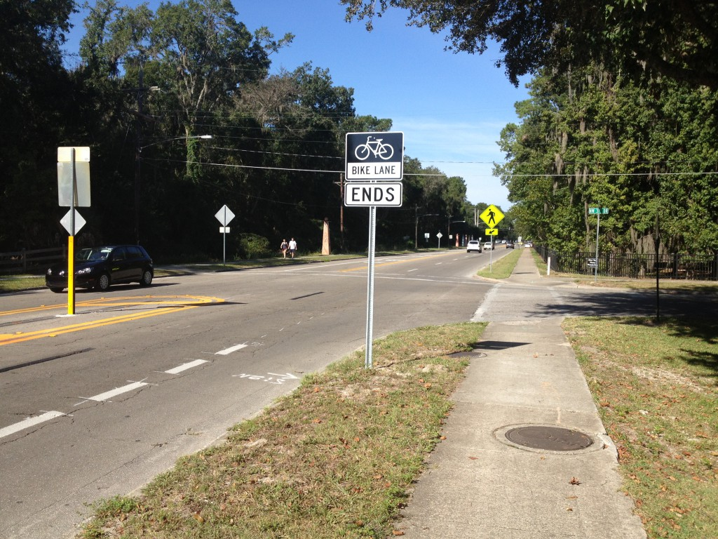 The temporary bike lane going west along Northwest Eighth Avenue ends at Northwest 31st Drive. The City of Gainesville is conducting a trial in which Eighth Avenue is reduced from four to two lanes with adjacent bike lanes from Northwest 31st Drive to Northwest 23rd Street.