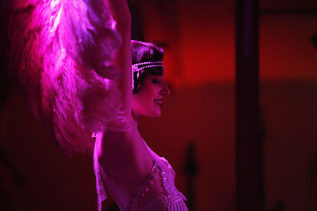 Tessa Paulsen, founder and artistic director of The Manic Menagerie Vaudeville Company, performs a burlesque act at The JAM on Saturday.