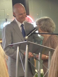 Gov. Rick Scott hands the Great Floridian Award to Dr. James Robert Cade's widow, Mary Cade.