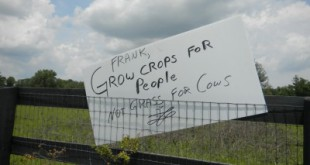 One of many protest signs outside building dedication ceremony in 2012 to honor Adena Springs owner, Frank Stronach.